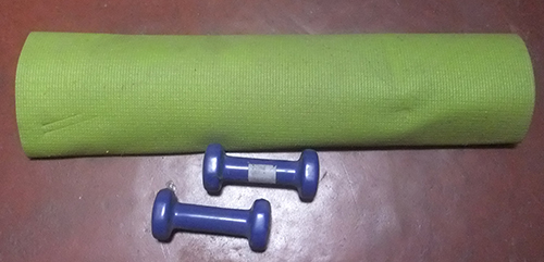 yoga mat and dumbbells